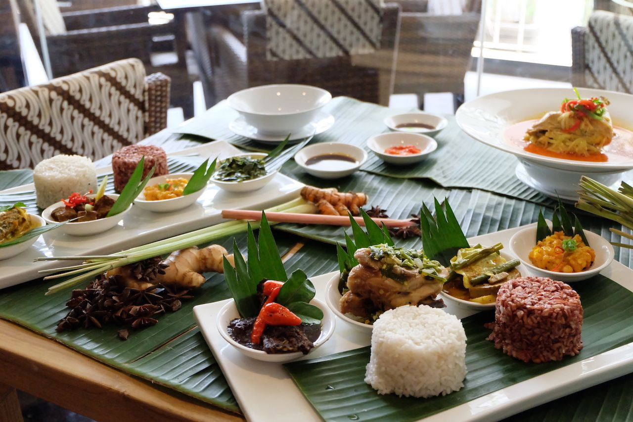 Traditional Indonesian meal laid out on a table