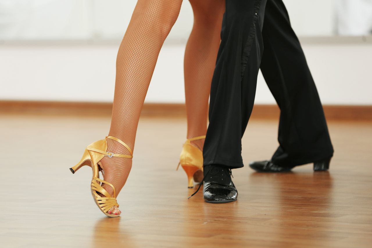 Two people ballroom dancing
