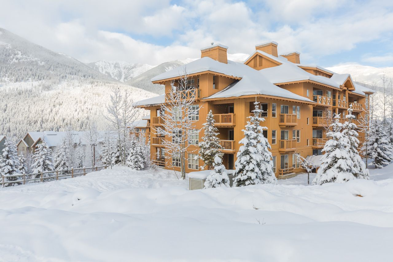 Winter vacation town homes or condos in a mountain ski resort covered with snow