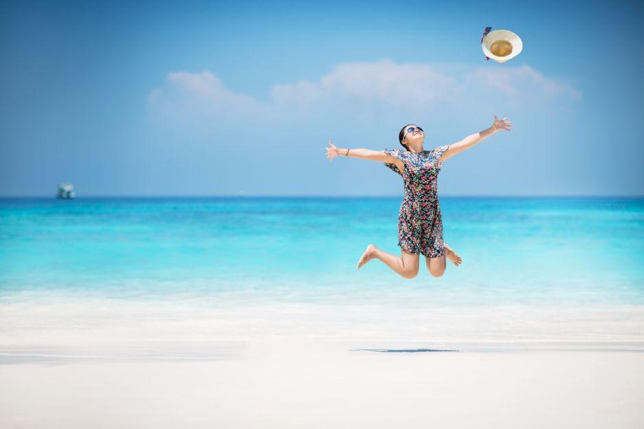 Woman beach jump