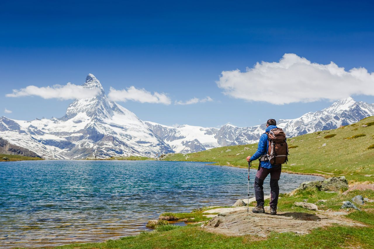 hiker with backpack on the triail near Matterhorn