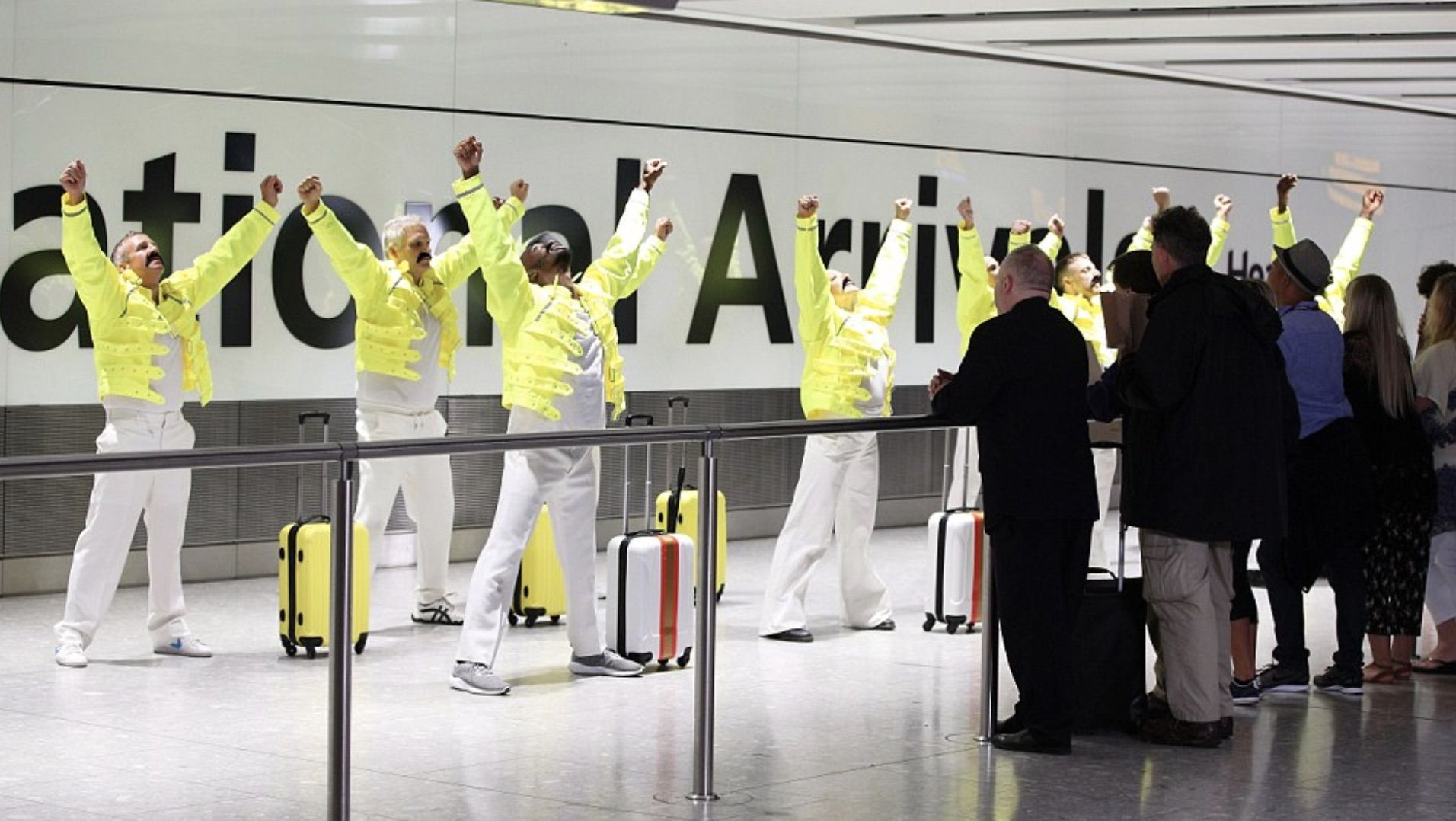 Baggage handlers at Heathrow in London celebrating Freddie Mercury