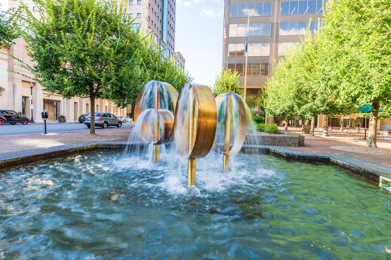 A bronze ring fountain in the middle of downtown Louisville