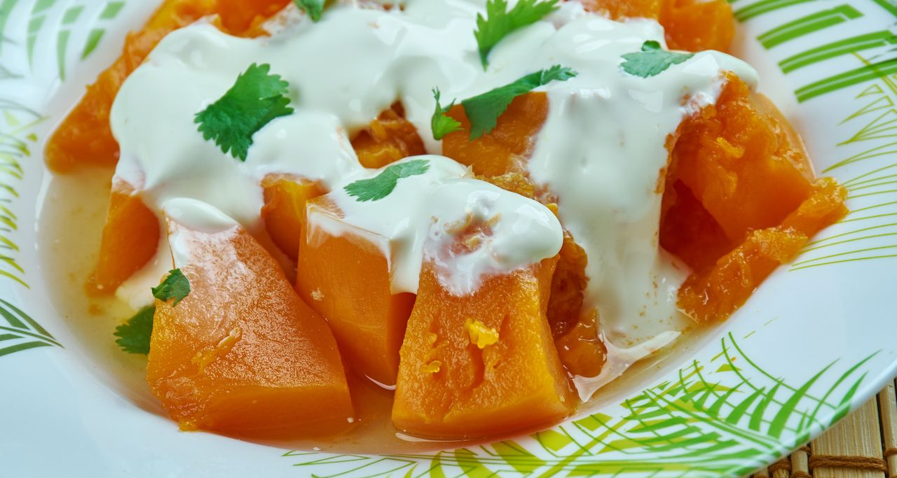 Afghan and Turkish pumpkin dish made by frying pumpkin topped with sour cream