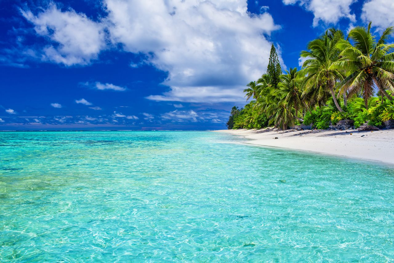 Amazing beach with white sand and palm trees on Rarotonga, Cook Islands