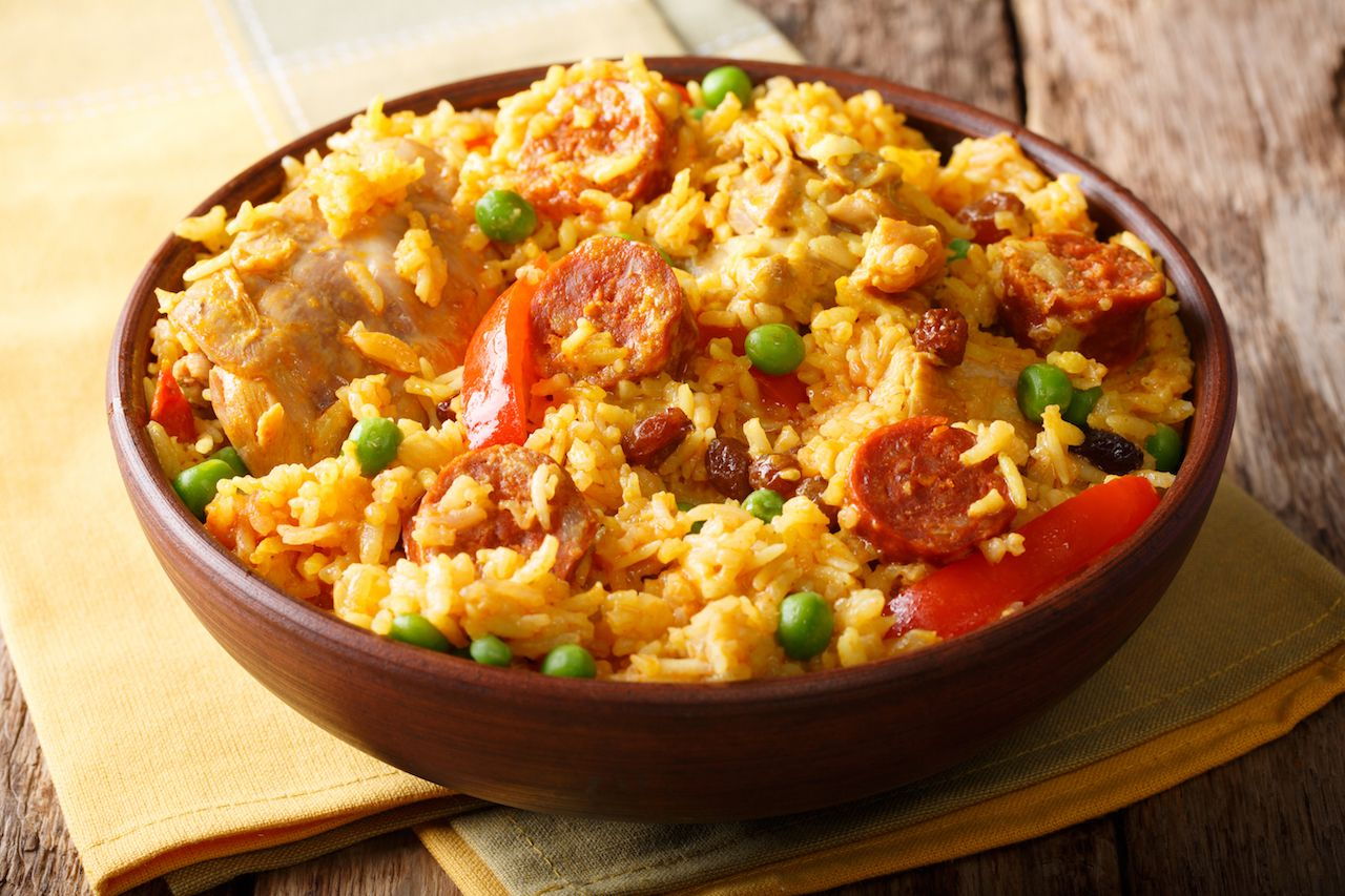 Arroz Valenciana with rice, meat, sausage, grapes and vegetables
