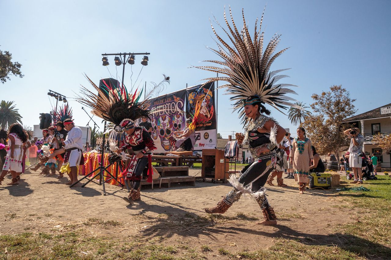 Aztec dancers celebrate Day of the Dead in San Diego, California