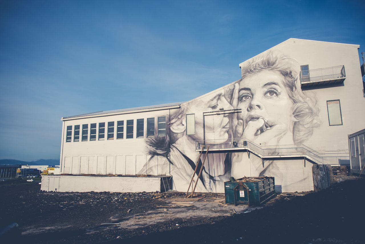 Black and white mural of two women on the back of the building in Reykjavik, Iceland