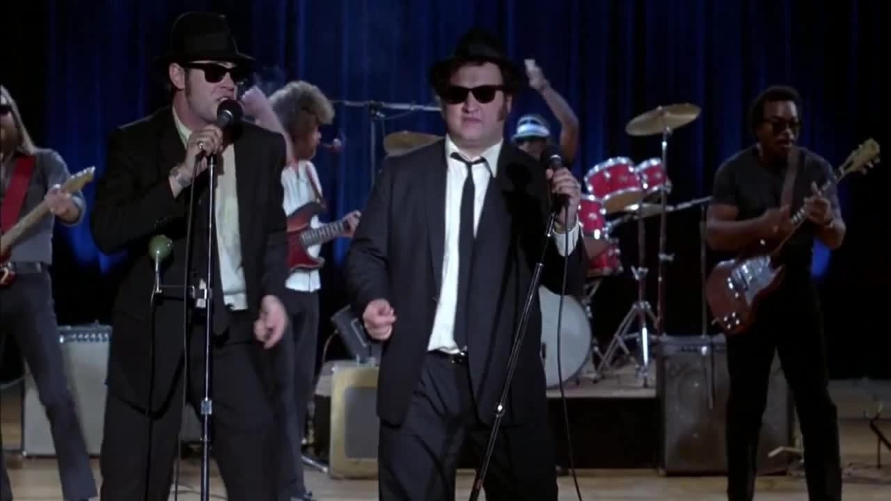 Blues Brothers shot of band singing