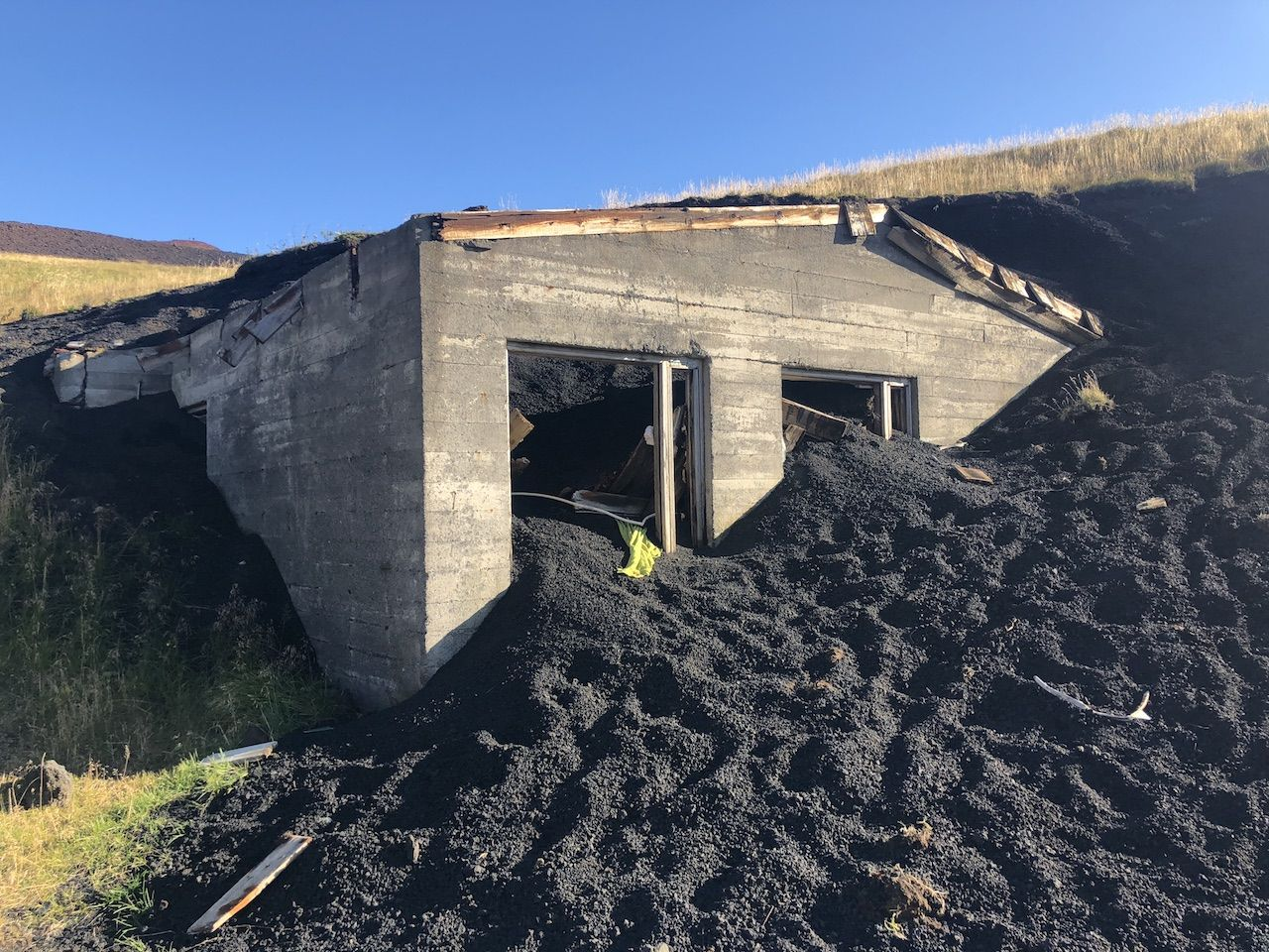 Building buried in ash at the Eldfell volcano in Iceland
