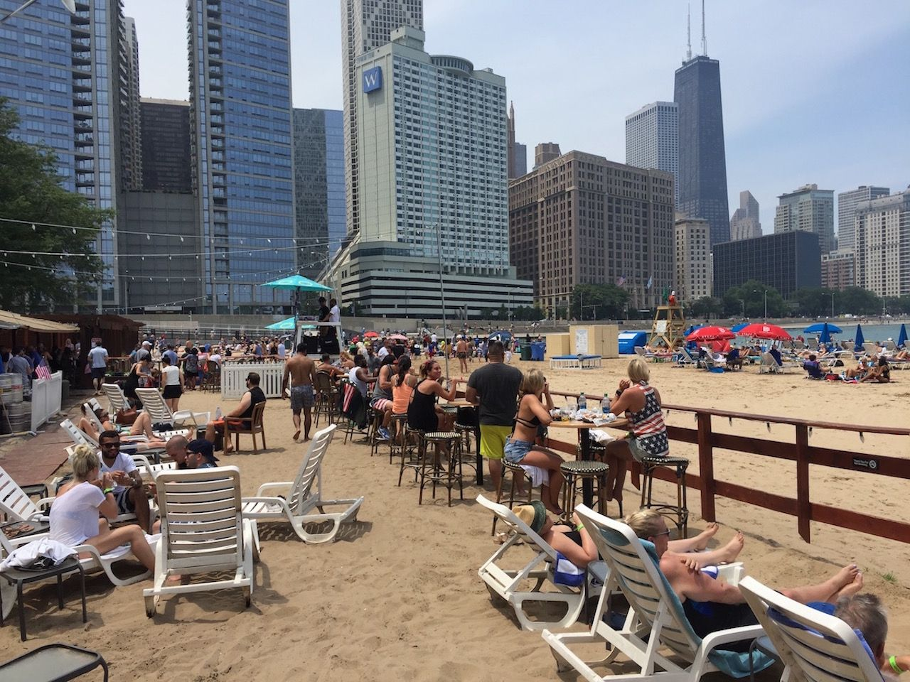 Caffe Olivia chairs in the sand opposite Chicago skyline