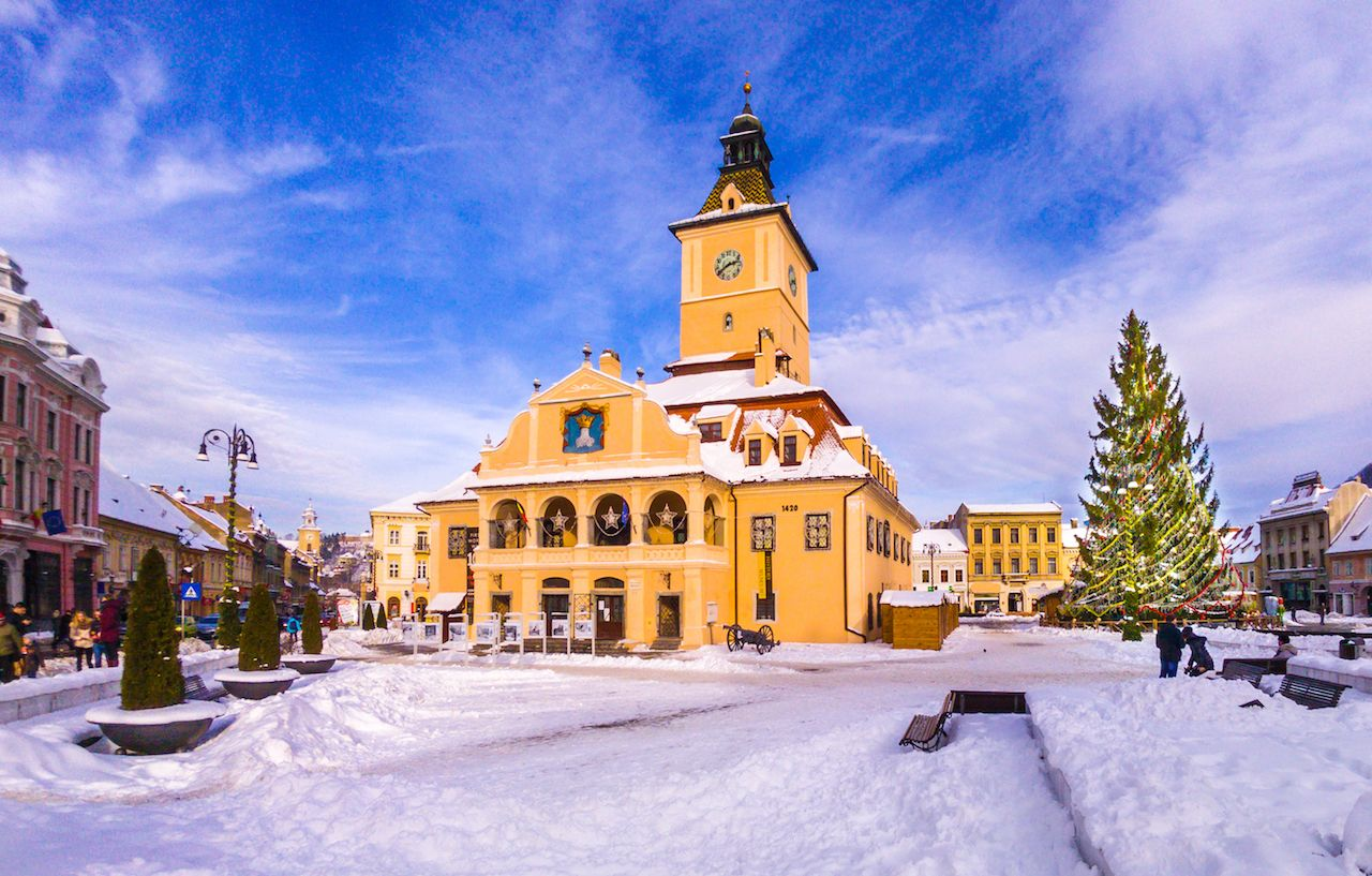 Christmas market and decorations tree in the main center of Brasov city in Romania