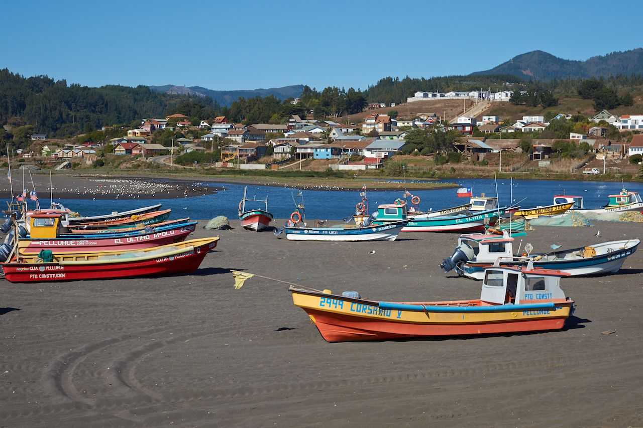 Colorful fishing boats on the beach in the small fishing village of Curanipe in the Maule Region of Chile