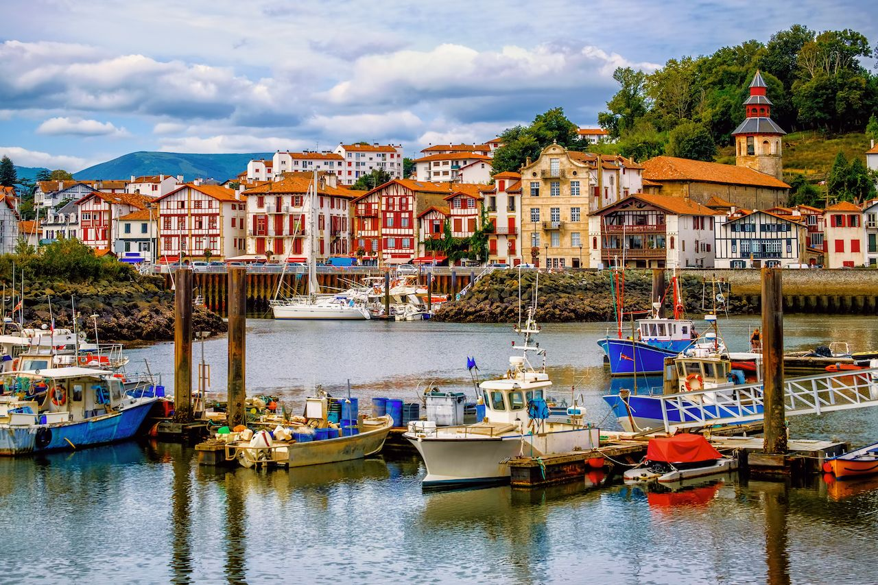 Colorful traditional basque houses in Saint-Jean-de-Luz harbor Old Town, France