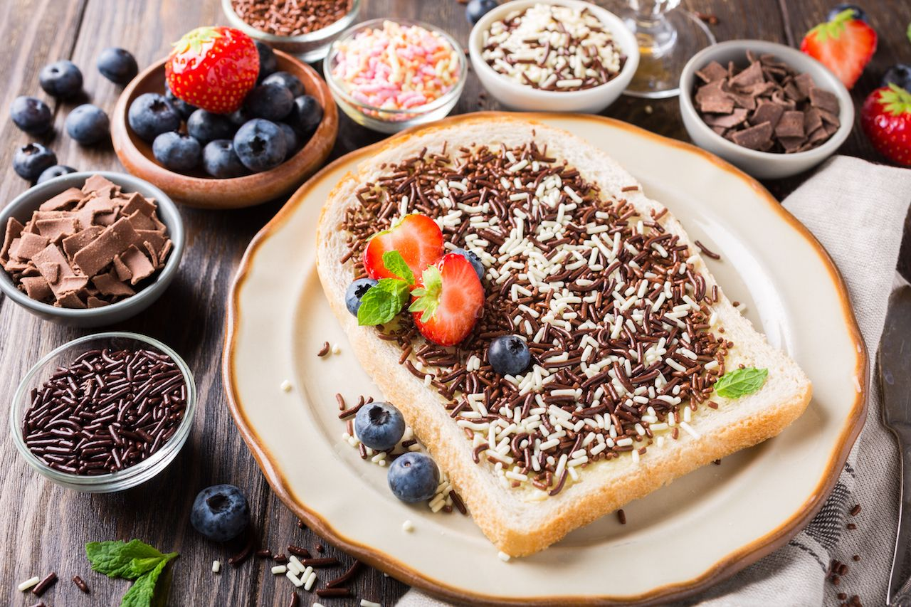 Dutch breakfast, slice of bread with hagelslag chocolate sprinkles and berries