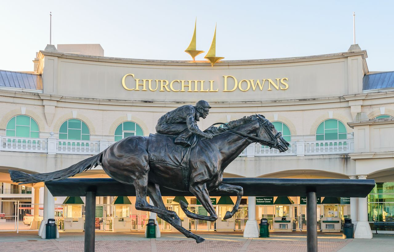 Entrance to Churchill Downs featuring a statue of Kentucky Derby Champion Barbaro