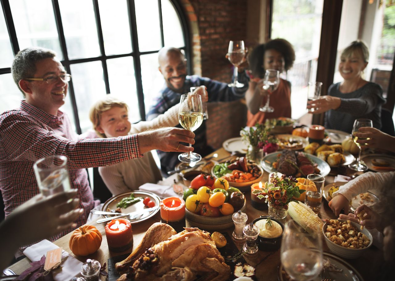 Family gathered around a Thanksgiving table