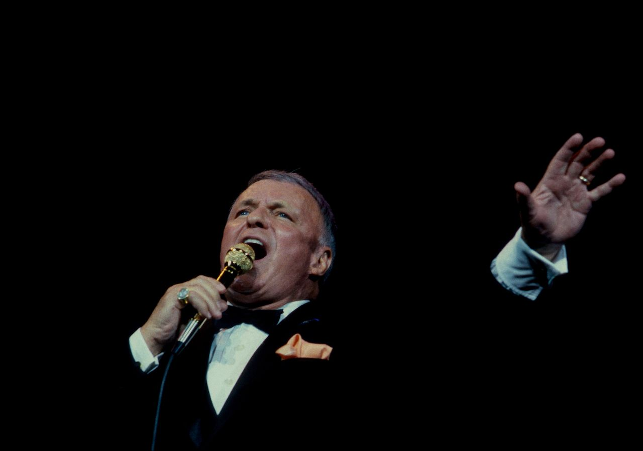 Frank Sinatra performs at the reopening of the Chicago Theater