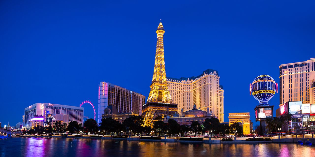 Las Vegas mini eiffel tower, casinos, and city done up in lights