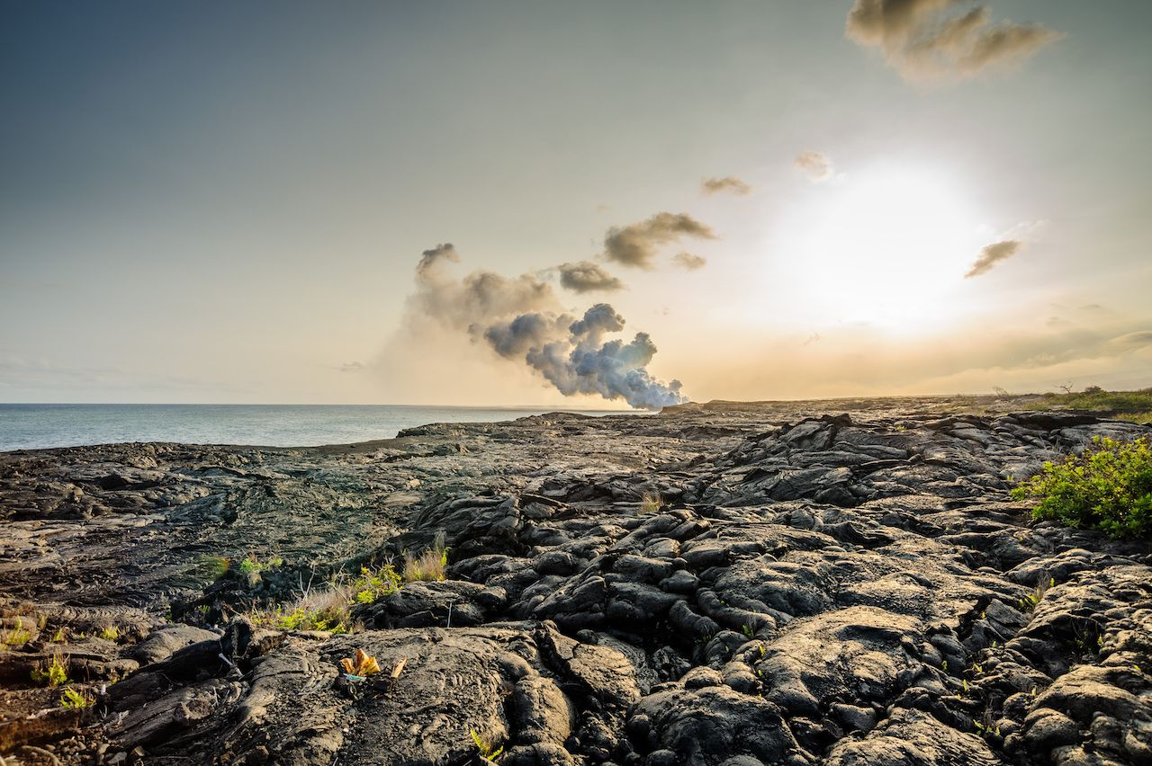 Lava rock and smoke from small volcanic eruption in Hawaii