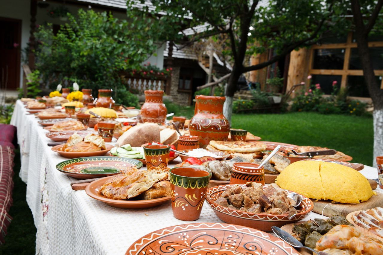 Long table piled with homemade Moldovan food