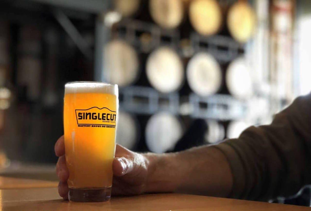 Man holding a beer, Singlecut Beersmiths