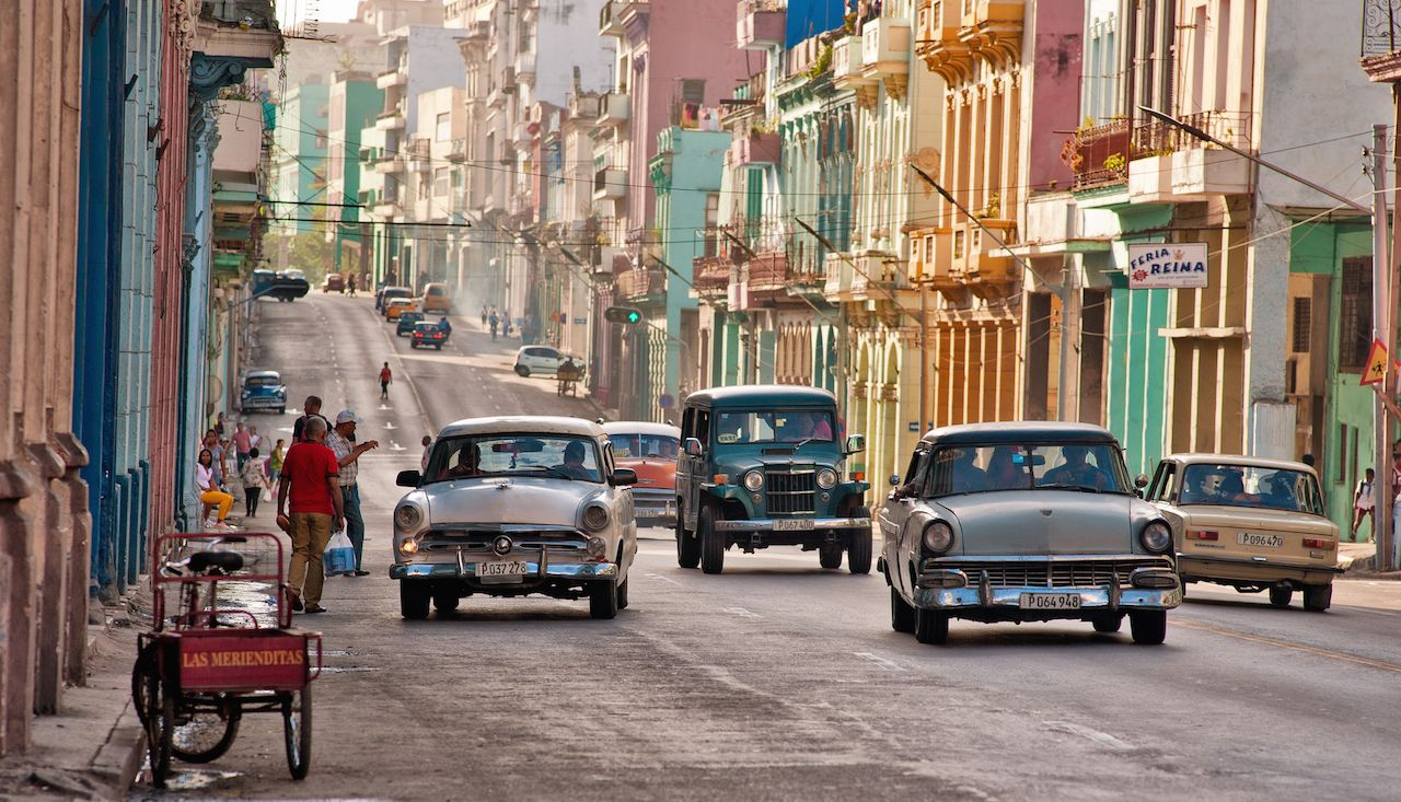 Old cars transiting in an avenue of Havana, Cuba