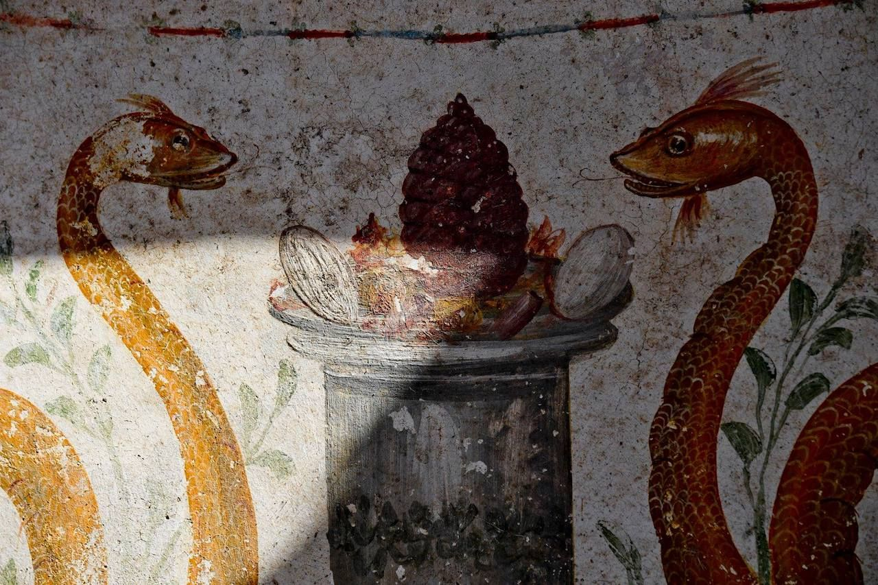 Paints on the walls of a shrine in the ruins of Pompeii, Italy