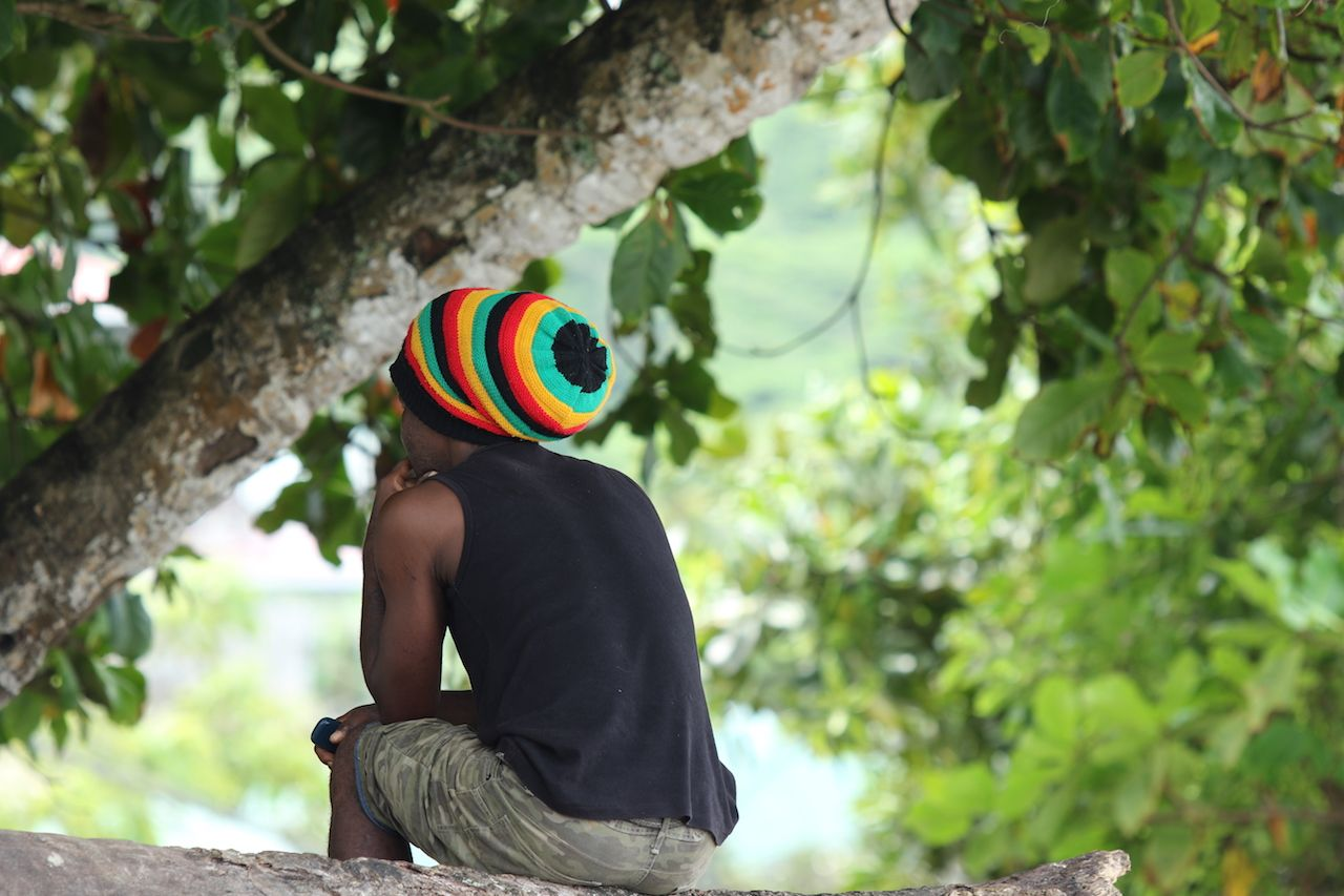Rasta man with traditional striped hat