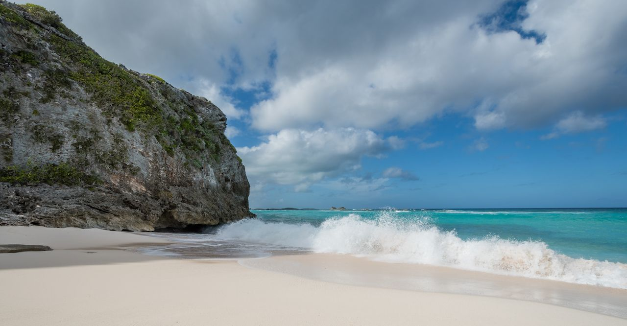Rocky cove and wave break at Mudjin Harbor, North Caicos, Turks and Caicos Islands