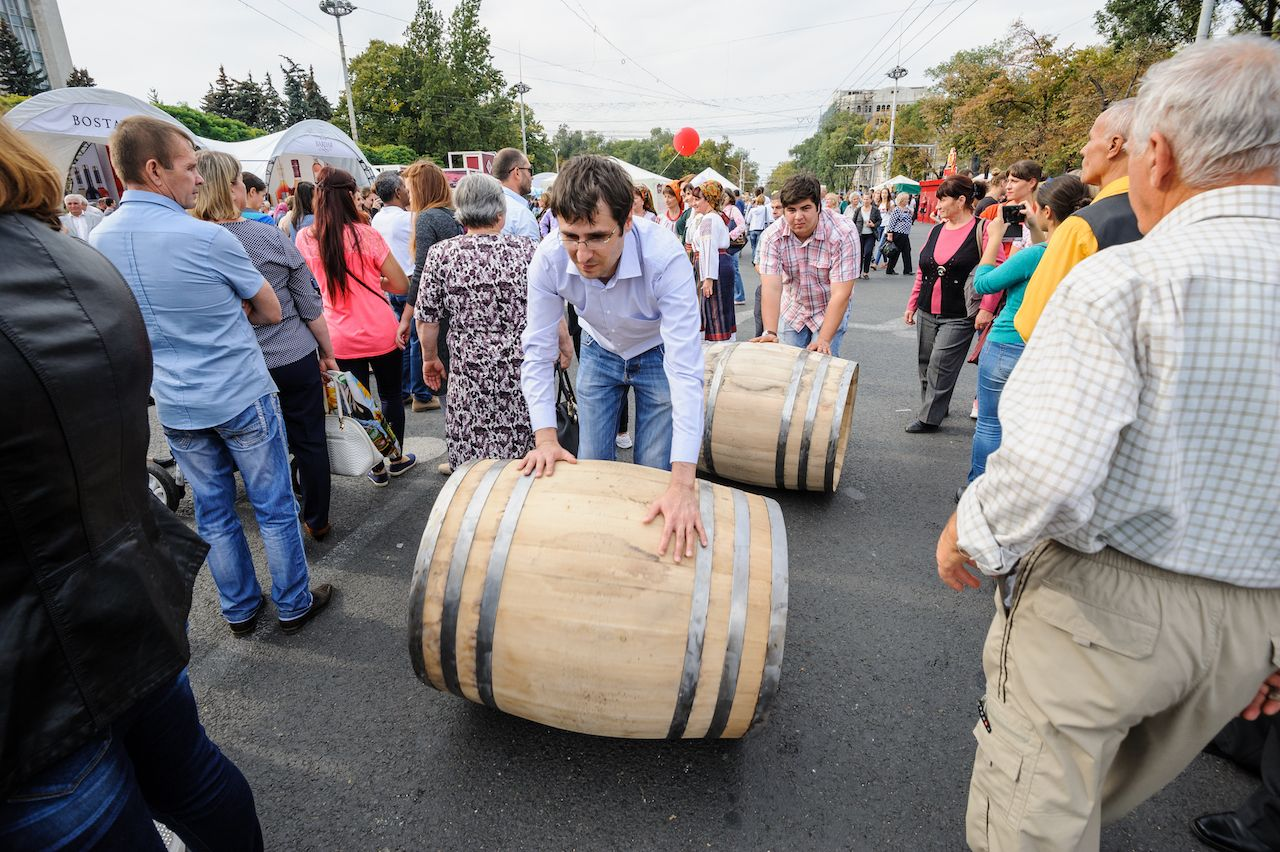 Rolling wine barrel to celebrate National Wine Day in Moldova