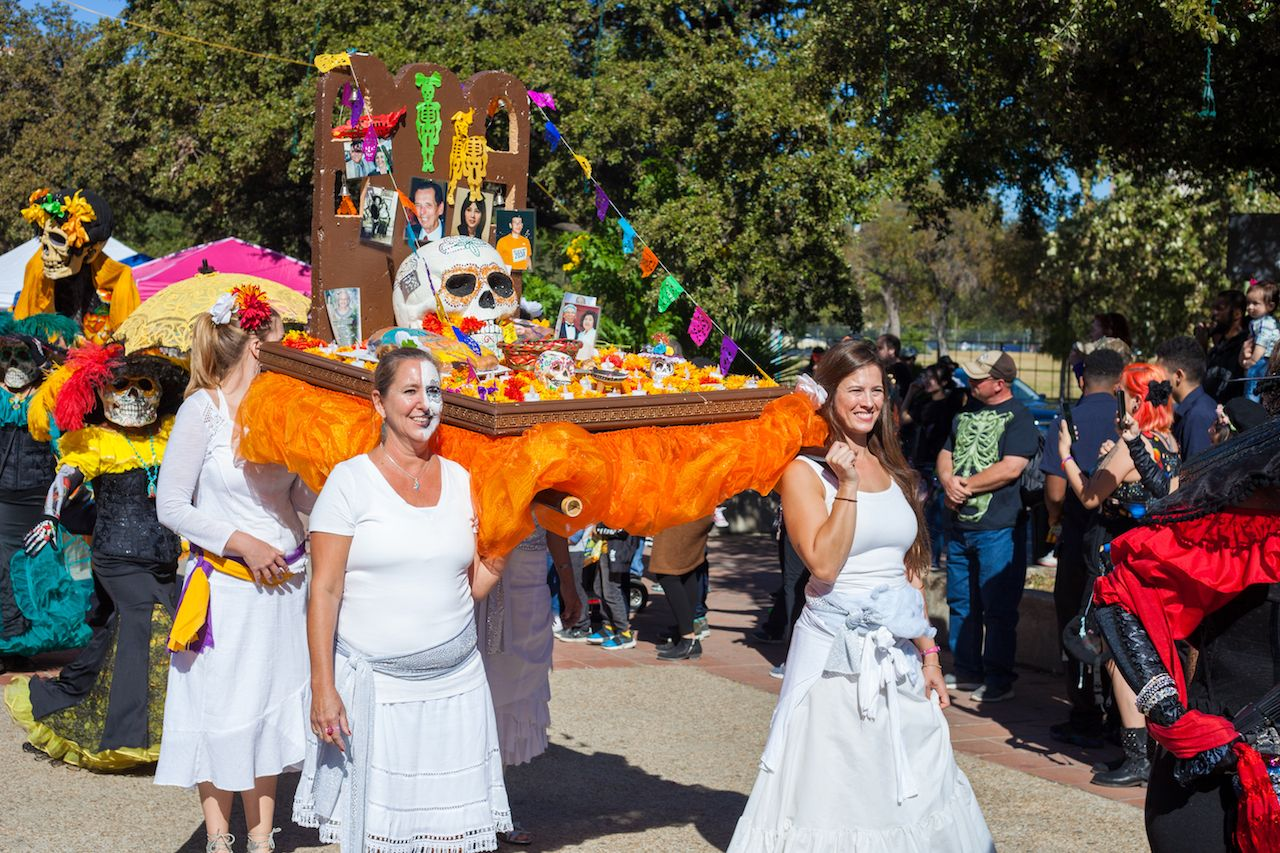 San Antonio women carry commemorative altar in the traditional Day of the Dead procession