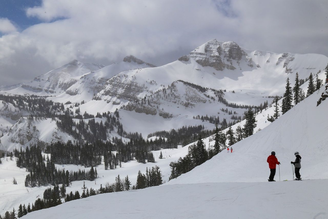 Skiers on a snowy mountain in Wyoming