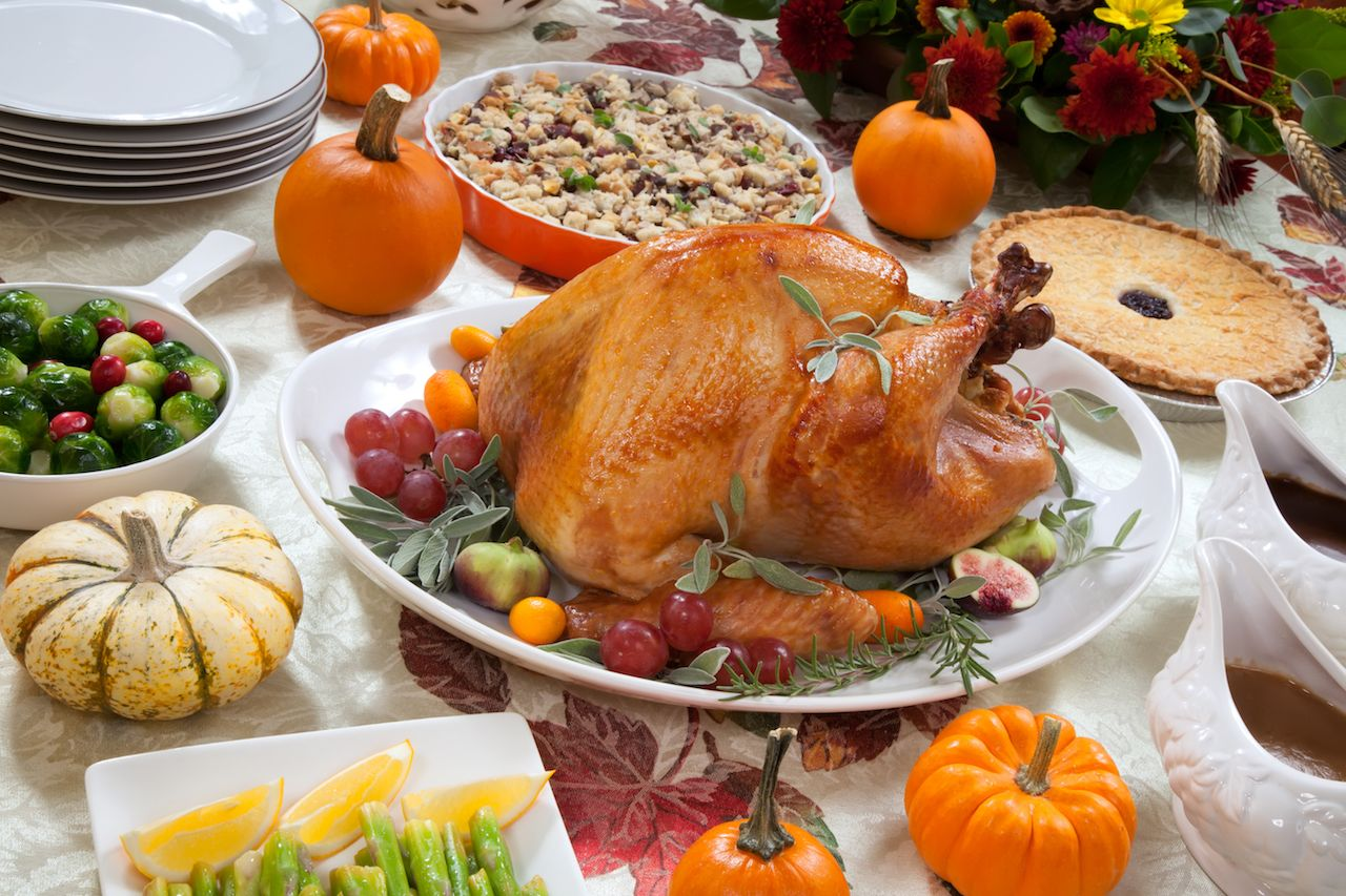 Thanksgiving turkey, pie, and sides on a harvest table