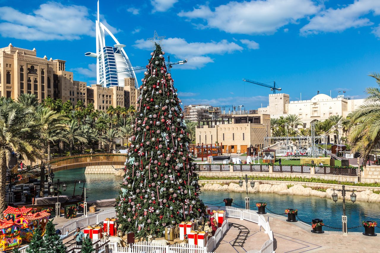 View at Burj Al Arab Hotel from Madinat Jumeirah and Christmas Tree in Dubai, UAE