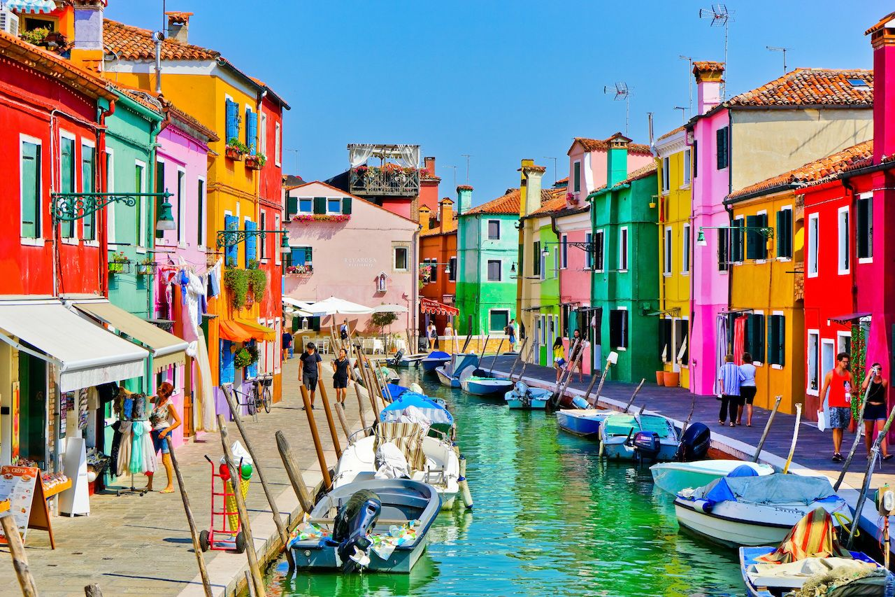 View of the colorful houses along the canal at the Islands of Burano in Venice