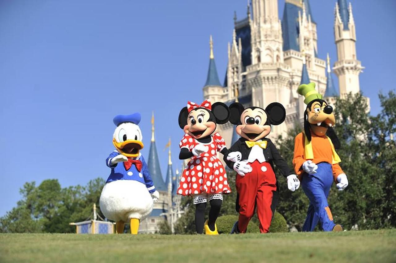 Costumed characters in front of the castle at Walt Disney World