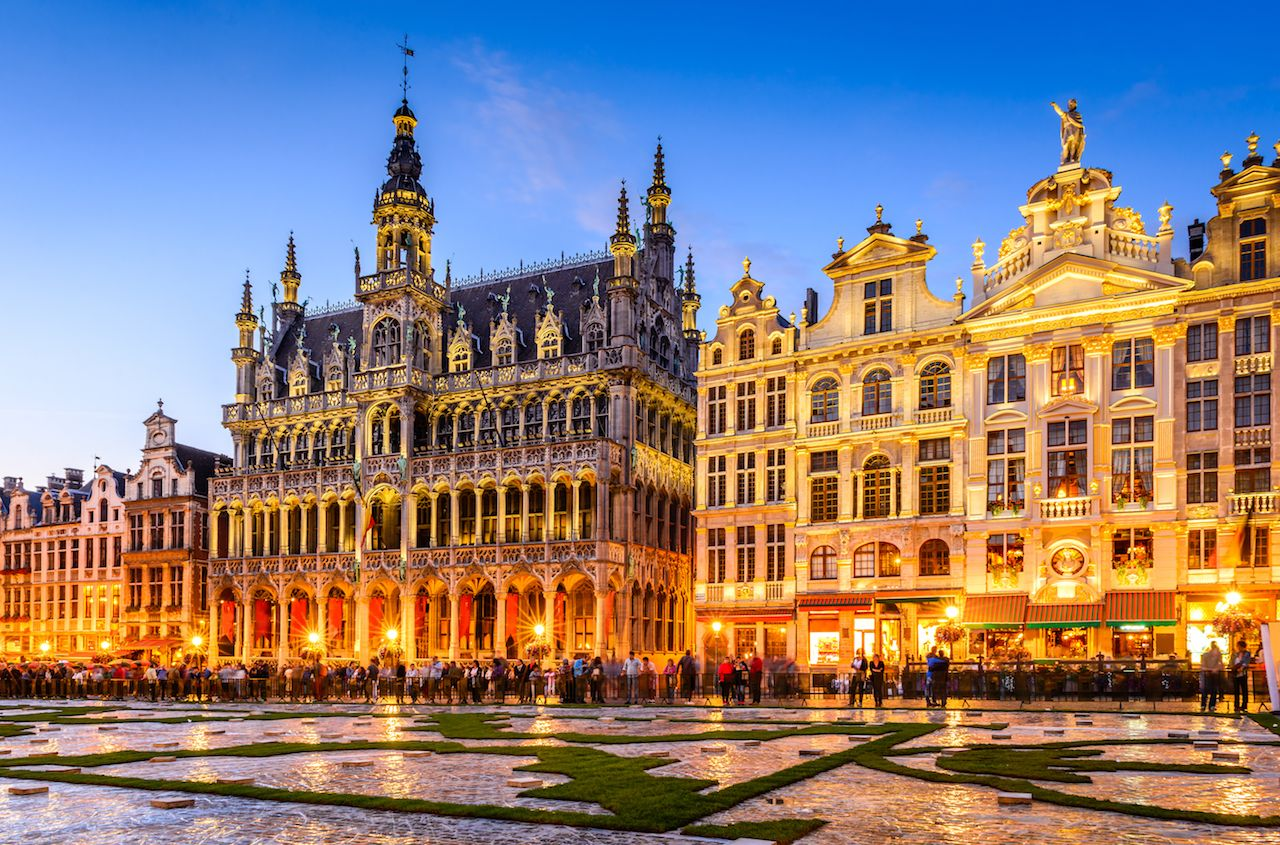 Wide angle night scene of the Grand Place and King's House in Brussels, Belgium