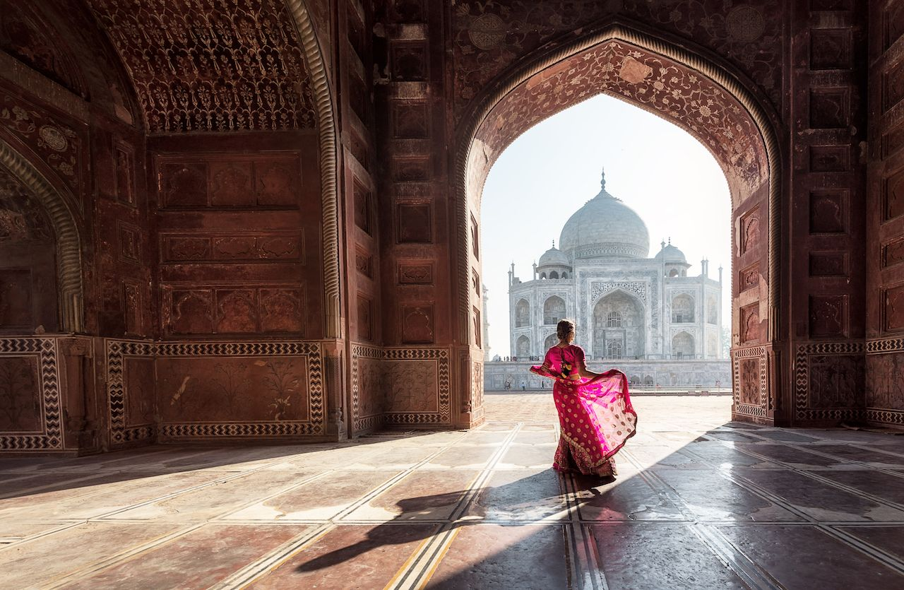 Woman in pink sari at the Taj Mahal in India