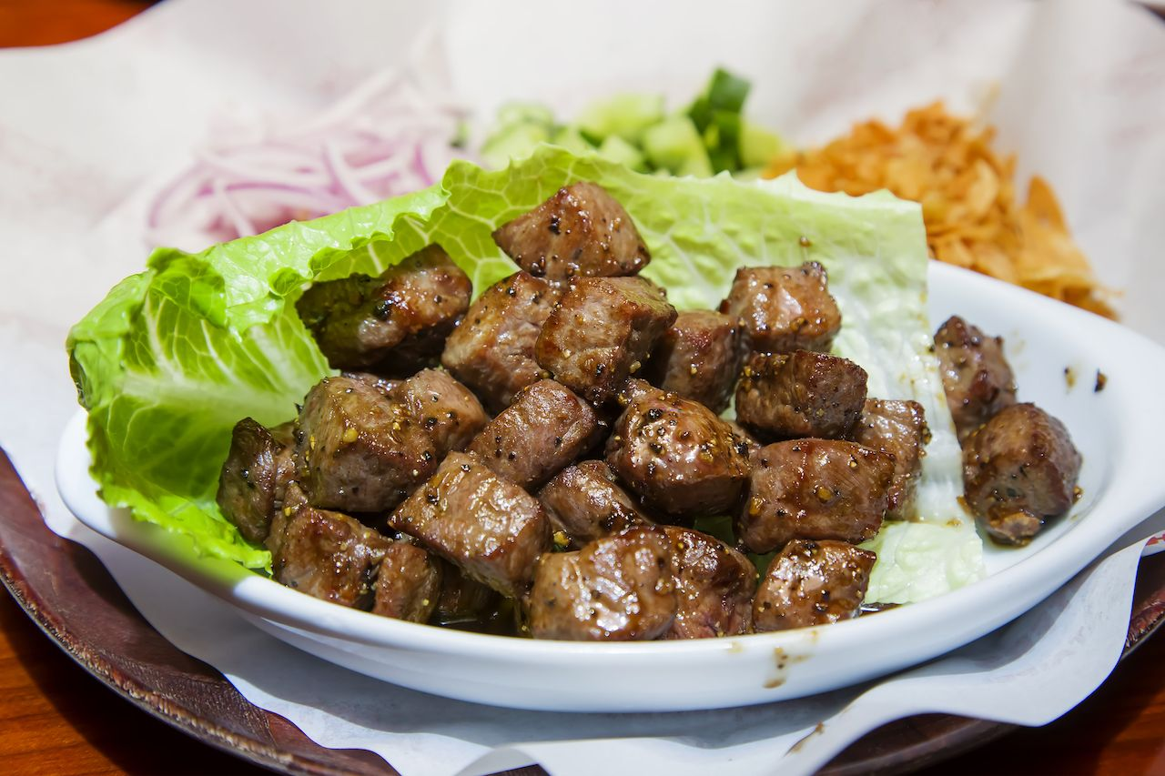 garlic beef cubes in a lettuce leaf