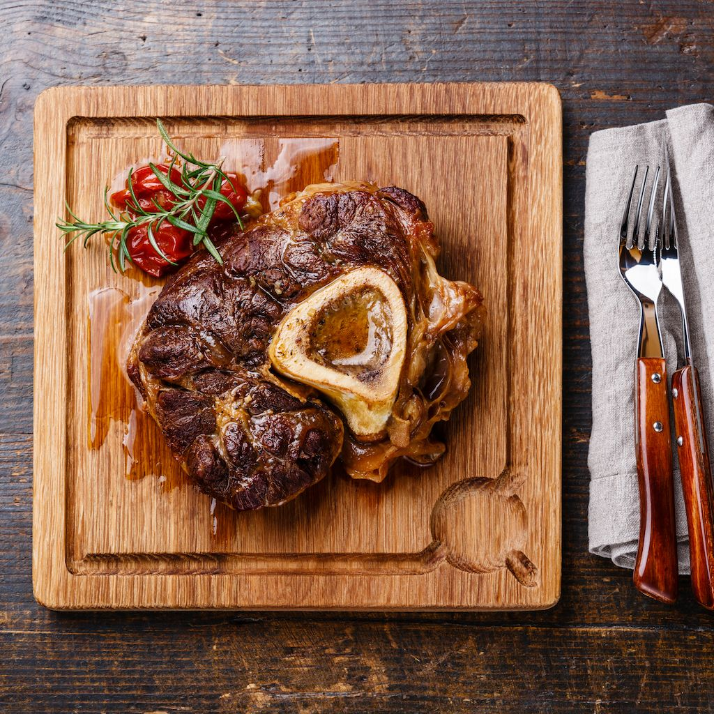 osso bucco on a wooden cutting board