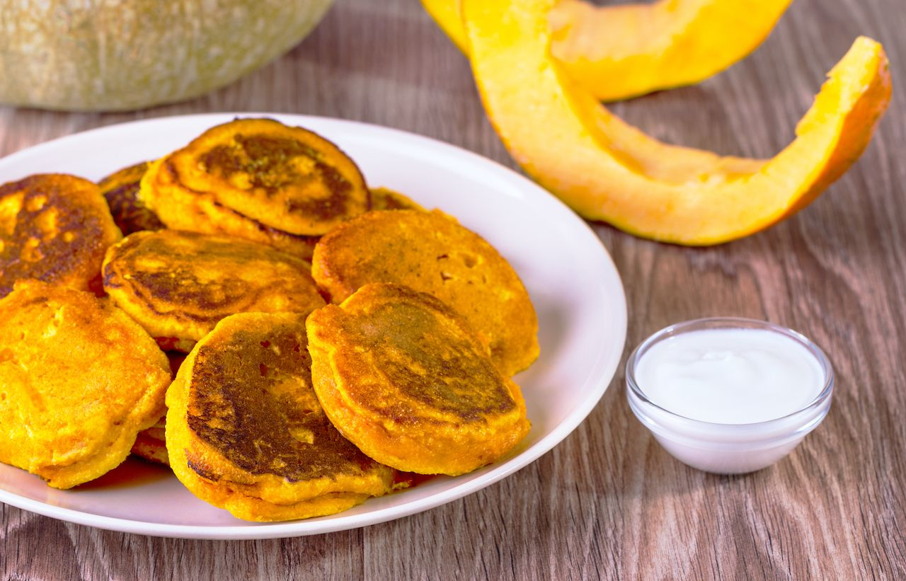 pumpkin pancakes on a plate with dipping sauce