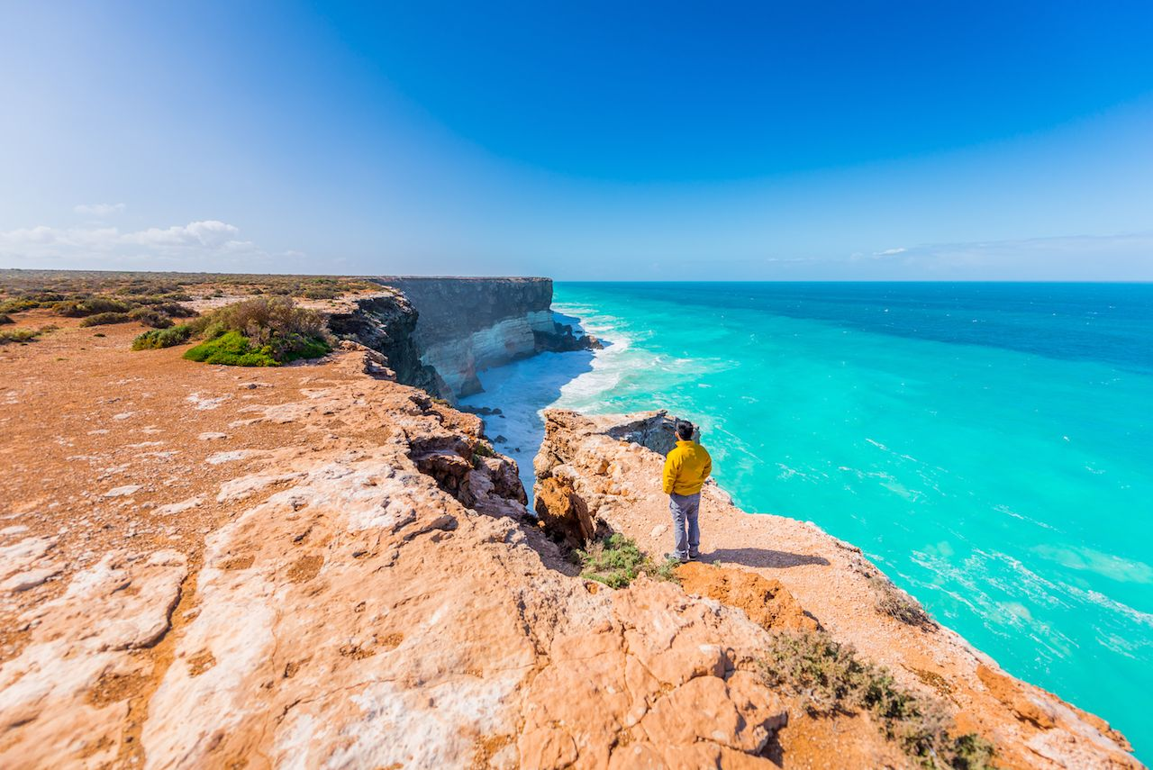 A man admires the scenic view at The Great Australian Bight