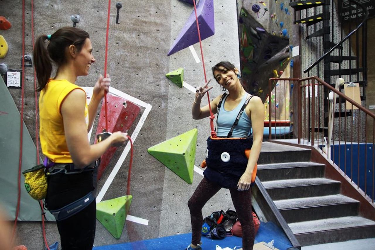 Climbers wearing harnesses at the Boulder Rock Club