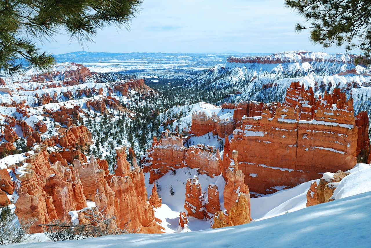 Bryce canyon panorama with snow in winter with red rocks and blue sky