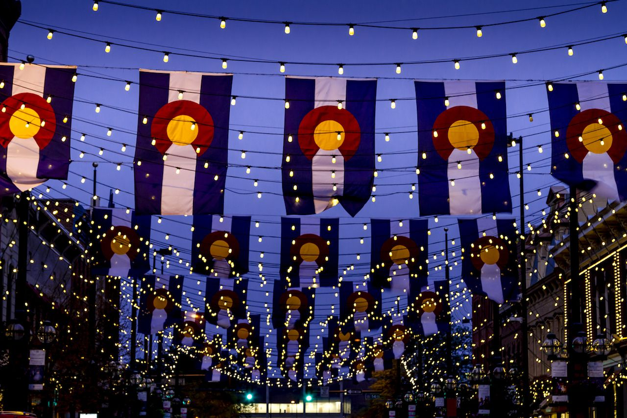 Colorado State Flags and bistro lights in historic Larimer Square in downtown Denver