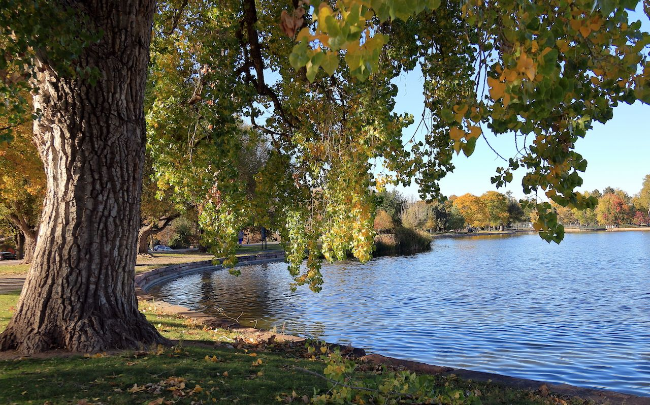 Fall foliage colors at Washington Park by the lake in Denver, Colorado