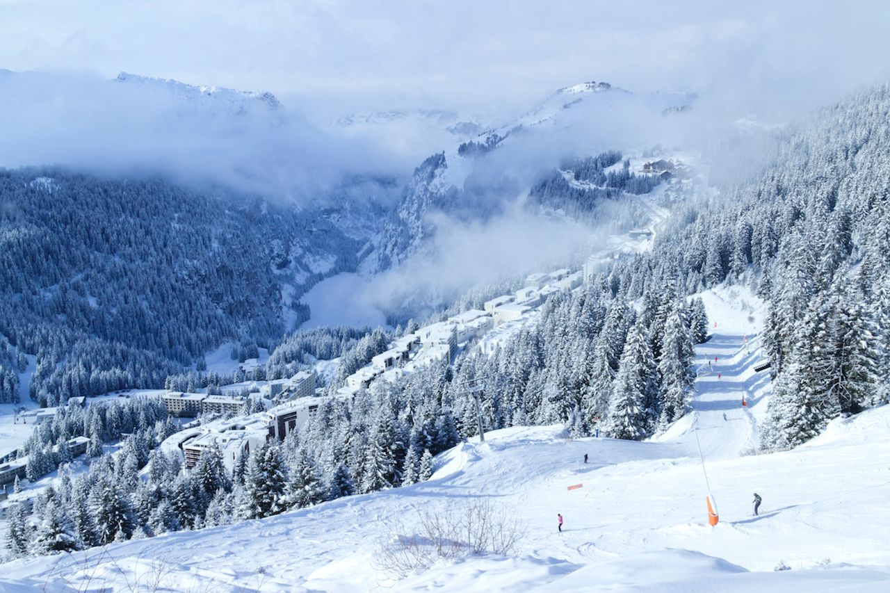 Flaine, Grand Massif, Alps, France, with low clouds in the valley