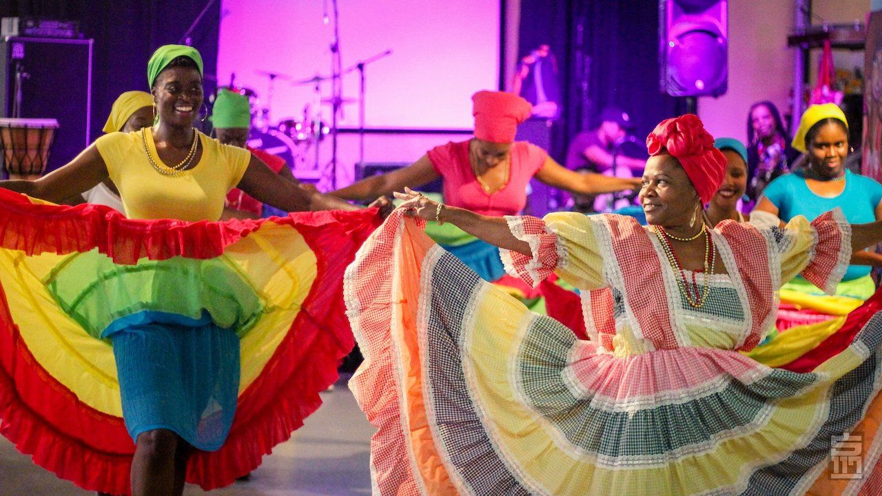 Haitian dancers dancing during Haitian Market Day