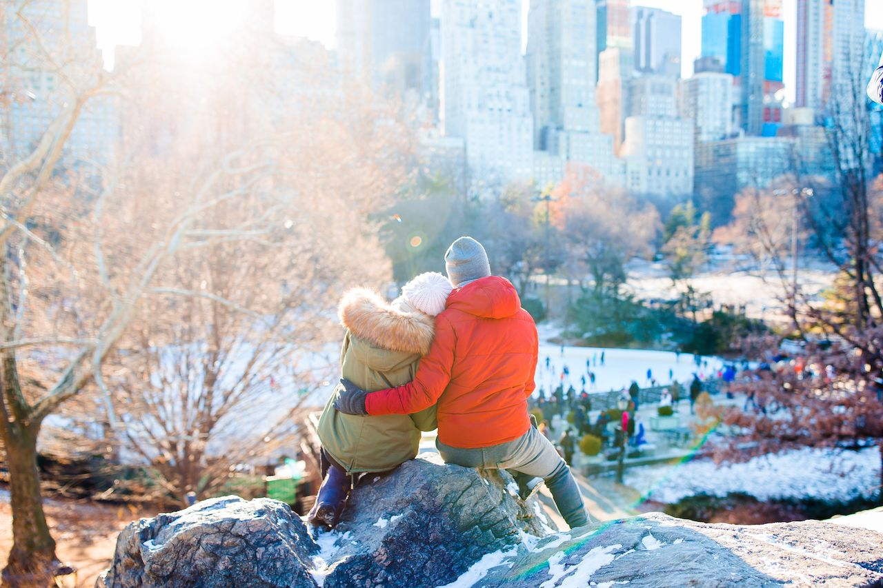 Happy couple enjoying the view of famous ice-rink in NYC